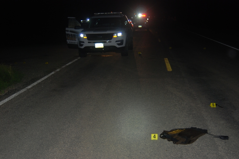 "Bowman/Monteith police shooting scene. Deputy Brad Bowman told BCI he shot Monteith inside the police vehicle because Monteith had a knife. Note marker number five (5) that shows a knife far away from the vehicle. Pembina County State's Attorney Ryan Bialis said witness Sara Ramos Letexier was mistaken when she believed she witnessed a man (Clifford Edward Monteith III - 6' 3"" - 214 lbs) laying on the highway. Bialis said Letexier actually saw Bowman's carrier vest (shown above)"